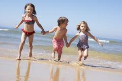 Children Running Along Beach Royalty Free Stock Photo