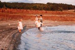 Children Running Along Beach Royalty Free Stock Photography