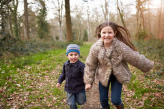 Children Running Along Path In Countryside Together Royalty Free Stock Images