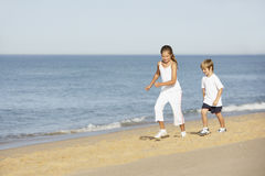 Children Running Along Sand On Beach Holiday Stock Photography