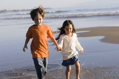 Children Running on Beach Royalty Free Stock Images