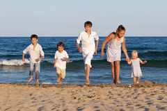 Children are running on beach Stock Images
