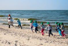 Children running  at beach Royalty Free Stock Photos