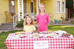 Children Running Charity Bake Sale Royalty Free Stock Images