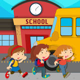 Children running in front of school Stock Photos