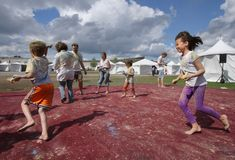 Children Running during Holi Stock Photos