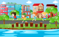 Children running on logs in park Royalty Free Stock Photos