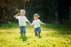 Children Running in Meadow Royalty Free Stock Photos