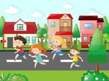 Children running in the neighborhood Royalty Free Stock Photos