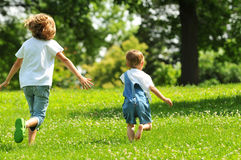 Children running outdoors Royalty Free Stock Photo
