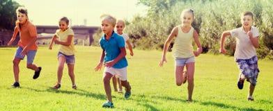 children running in park Royalty Free Stock Photos