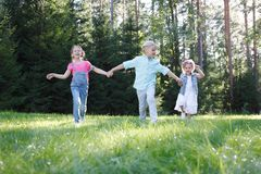 Children running in park royalty free stock images