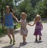 Children running in a Park New York USA stock photos