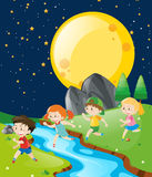 Children running in the park at night Royalty Free Stock Photography