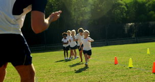 Children running in park during race. On a sunny day stock footage