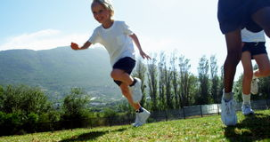 Children running in park during race. On a sunny day stock video footage