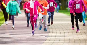 Children running in the park. Summer race Royalty Free Stock Image