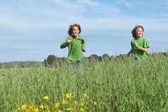 Children running playing outdoors Royalty Free Stock Photography