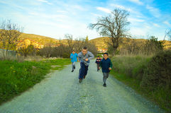 Children running a race Royalty Free Stock Image