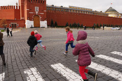Children running at the Red Square, Moscow Stock Photos