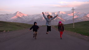 Children Running on the Road stock footage