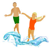 Children running in the summer to water. Girl and boy running swimming in the waves Stock Photo