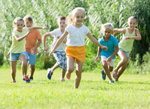 Children running together in park Stock Photos