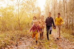 Children running together in a park. royalty free stock image