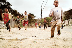 Children running in township, South Africa. Stock Image