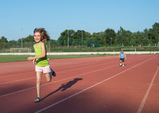 Children running. On the track Royalty Free Stock Images