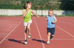 Children running. On the track Royalty Free Stock Image