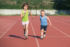Children running. On the track Stock Images