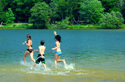 Children running into water Stock Photography