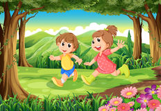 Children running at the woods Royalty Free Stock Photos