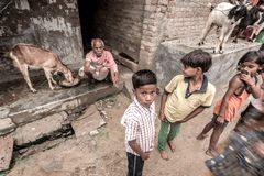 Children at rural village in India. Children in a poor rural village in India. Illiteracy is high amongst the dalits, the lowest caste in India and education is Royalty Free Stock Photography