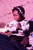 Children in rural village life in Tibet. Tibet is located on the highest plateau behind the might himalayas and life there is harsh with little rain and short stock images