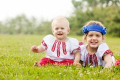 Children in russian folk clothes on grass Royalty Free Stock Photography