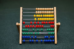 Children's abacus on the floor. isolated on background. Scores. Children's abacus on the floor. isolated on background Stock Photos