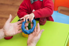 Children`s and adult hands molded ring of  clay Royalty Free Stock Images