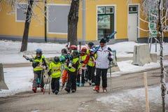 Children`s alpine ski school. Instructor and children students in colorful ski equipment stock photos