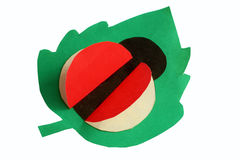 Children`s applique ladybug on green leaf Stock Image