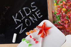 Children's area kids zone Space written on a blackboard with chalk, caramel, candy, star, wand, valentines day Royalty Free Stock Images