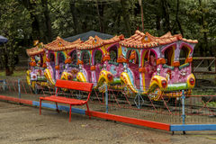 Children's attraction - the train, for entertainment in central park  in Targu-Jiu. Stock Photos
