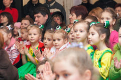 Children's audience. Small children audience of fancy-dress children's theatrical performance Royalty Free Stock Photo