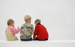 Children's backs. Three children's backs on white stock photography