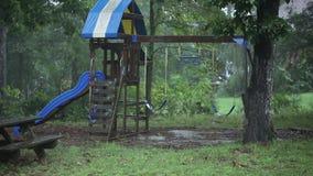 Playset during rain storm stock footage