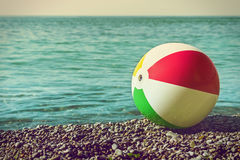 Children's ball on the beach against the sea Royalty Free Stock Photo