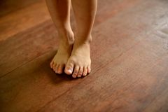 Children`s bare feet on wooden floor. Selective focus Royalty Free Stock Images