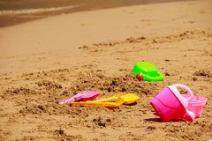 Children`s beach toys.Vacation image of children`s beach toys on the sand.Set of toy for children on the beach in day stock photography