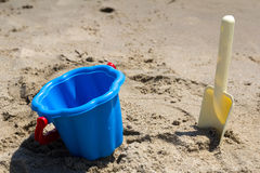 Children's beach toys - buckets and shovel on sand Stock Photography